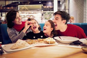 happy family dinning in a restaurant
